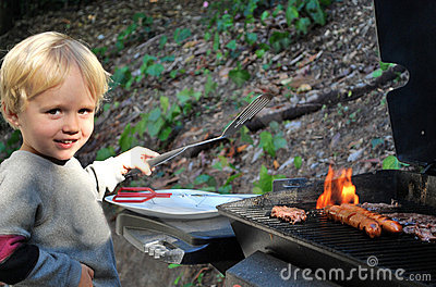 Young boy grilling food