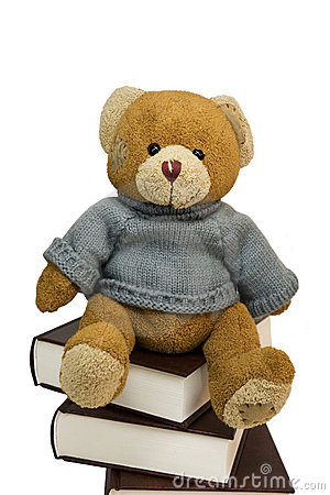 Teddy bear and pile of old books