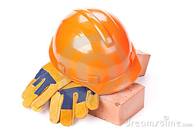Building bricks, hard hat and gloves