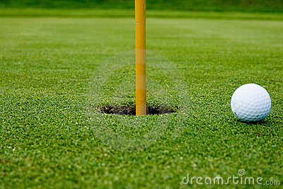 A golf ball in the hole green