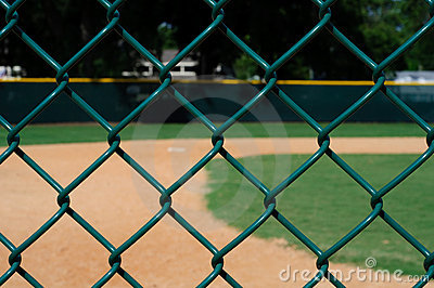 Empty Baseball Field through Fence