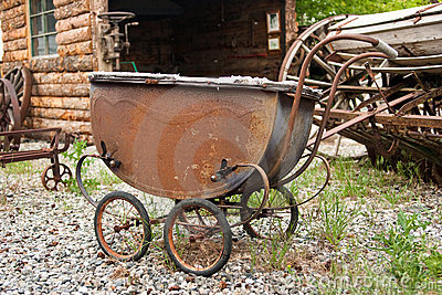 Rusting antique baby carriage