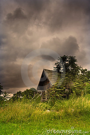 Cabin In The Middle Of Scenic Landscape