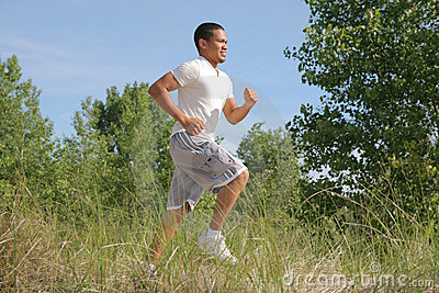 Young Man Jogging in the Woods
