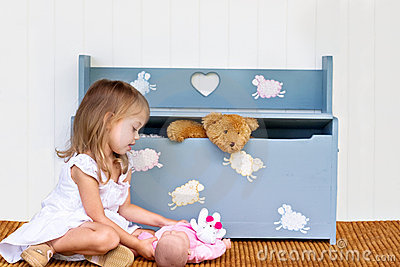 Child playing near toy chest.