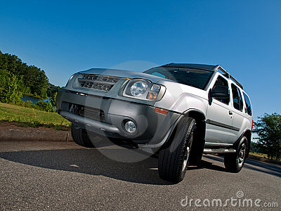 Silver Sports Utility Vehicle low pavement angle