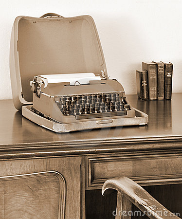 Old typewriter on writing desk