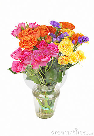 Color roses bouquet in glass vase.