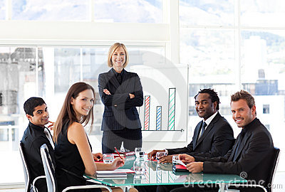 Businesswoman smiling at the camera in a meeting