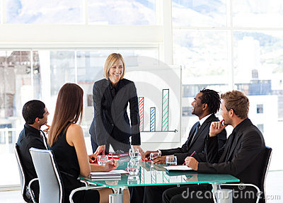 Businesswoman smiling at her colleagues