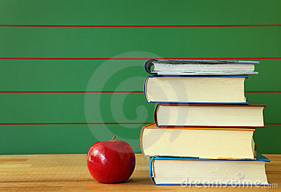Stack of book and red apple
