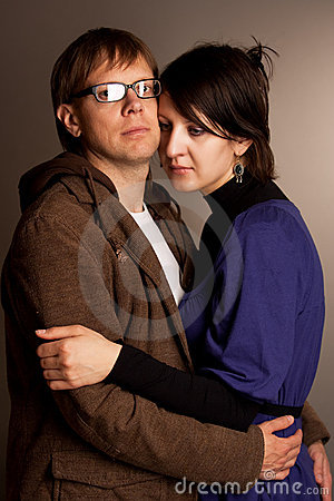 Young couple standing embrace
