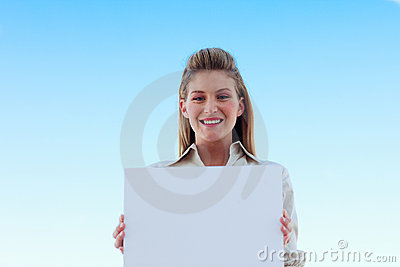 Businesswoman holding a white business card