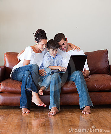Parents and son playing with a laptop