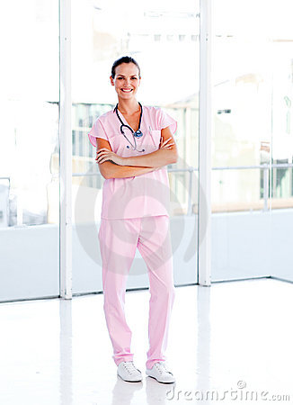 Beautiful nurse standing with folded arms