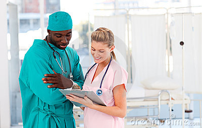 Surgeon and nurse working together