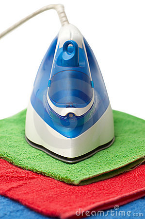 Flat smoothing iron on coloured towels