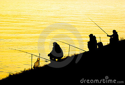Silhouettes of fishing men