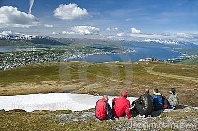 Hikers looking at Tromso city