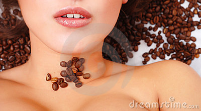 Woman's face with coffee  beans