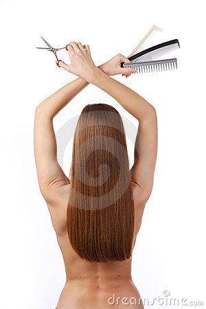 Woman with scissors and combs