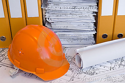 Orange helmet and project drawings