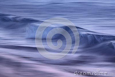 Waves on the ocean captured with a slow shutter speed