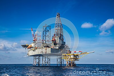 Offshore oil and gas drilling rig while completion well on oil a