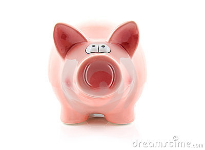 Pink piggy bank on white