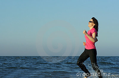 Running Exercising on the beach at sunset