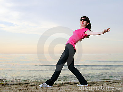 Exercising on the beach at sunset