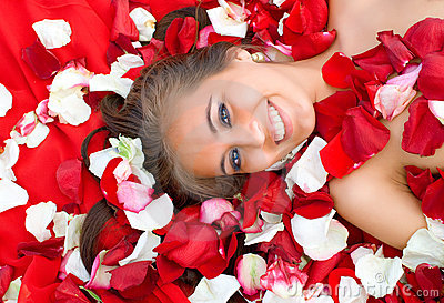 Beautiful young girl in rose petal