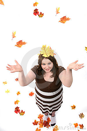 Teen as seen from above with fall leaves
