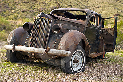 Rusted Abandoned Car in Desert