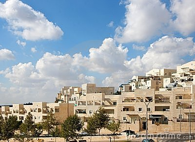 Street of new apartment buildings under blue cloud
