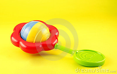 Colorful Baby Rattle on Yellow Background