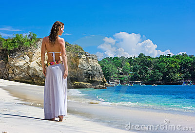 Brunette girl walking on beach