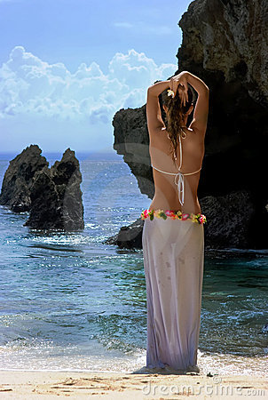 Cute brunette standing in front of the sea