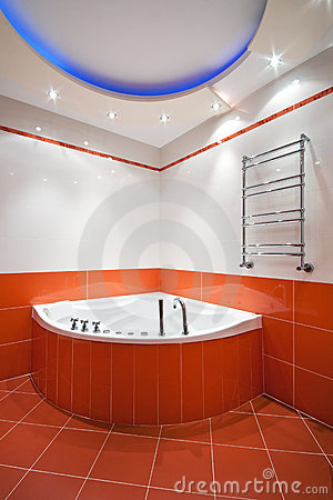 Bathroom in orange and white colors