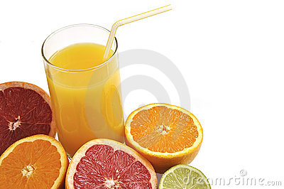 Glass of orange juice with fresh fruits.
