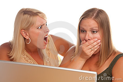 Two Shocked Women Using Laptop