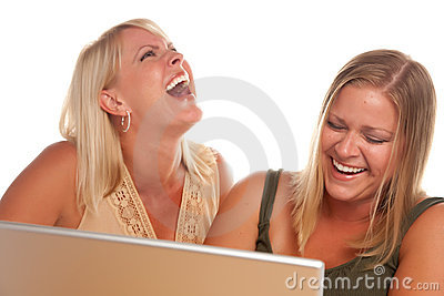 Two Laughing Woman Using Laptop