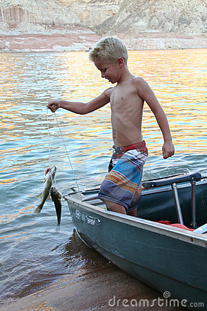 Young Boy Catches a Fish