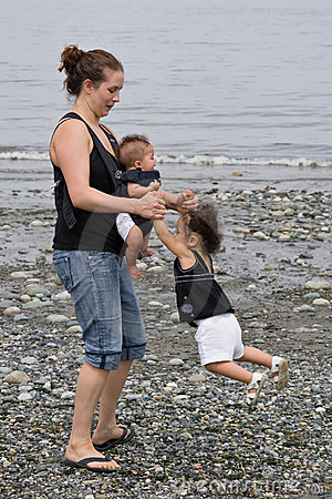 Young family playing at beach