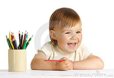 Child draw with red crayon