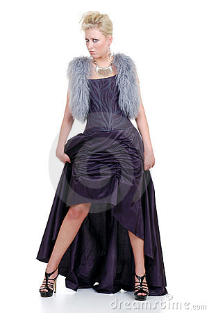 Blond woman with purple fur vest and dress posing