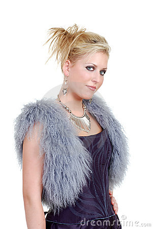 Cute blond woman wearing a purple dress a fur vest