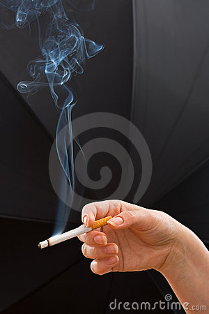 Woman hand holding a cigarette