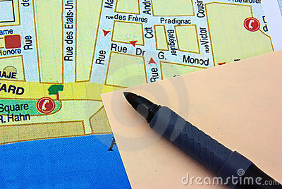 Sticky note with marker on a map