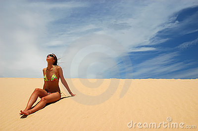 Woman sit on the sand